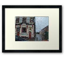 Ringo in the rain... Framed Print