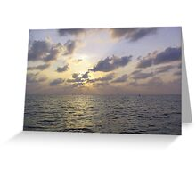 Sunset through the clouds over the water of the Arabian Sea off the Lakshadweep Islands Greeting Card