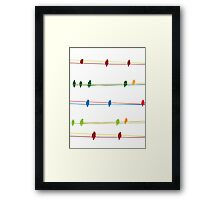 Birds on wire Framed Print