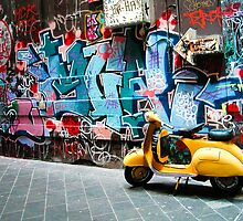 Yellow scooter in a Melbourne lane by Alexander Meysztowicz-Howen