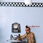 Punk in Diner by Chris Charalambous