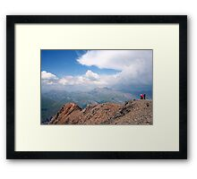 children looking over the alps Framed Print