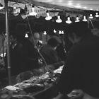 Paris market man buying fish  by neonflash
