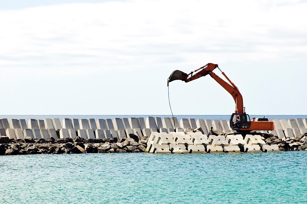 Heavy excavator machine in a pier construction site by mrfotos