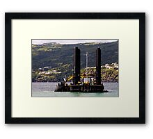 Dredger and barge working near the shore Framed Print