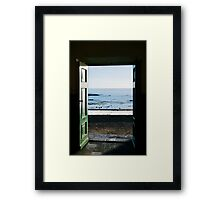 Ocean trough the door Framed Print