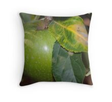 in amoungst the leaves a granny smith apple Throw Pillow