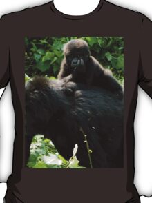 Young gorilla riding on mother T-Shirt