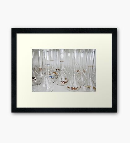 Belly test tubes standing in a chemistry lab Framed Print
