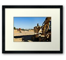 Excavators in a road construction site Framed Print