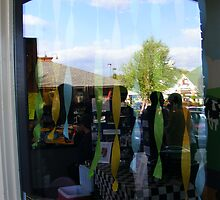 Reflection of sky in ben and jerry's window by raindancerwoman