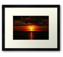 Red sunset on the ocean Framed Print