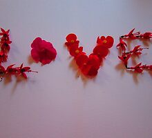the word 'love' in flowers by scarlettscoo