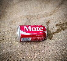 coca cola can washed up on sandy beach by morrbyte