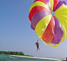 Riding a colorful para-sail behind a speedboat in the Lakshadweep Islands by ashishagarwal74