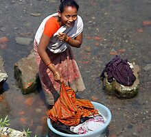 Assamese woman washing clothes by John Mitchell
