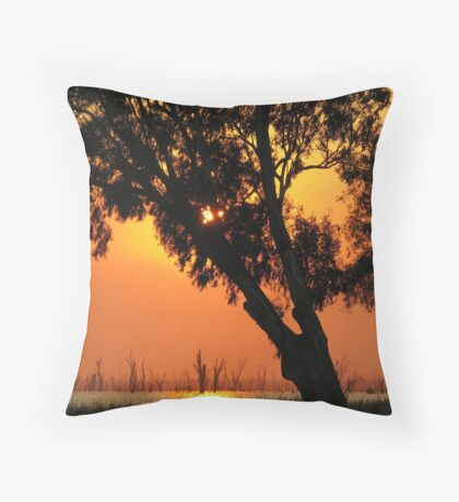 Trees silouetted against sunrise over Lake Mulwala Throw Pillow