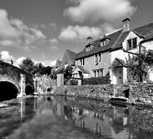 Castle Coombe Village In Wiltshire by JohnHall936