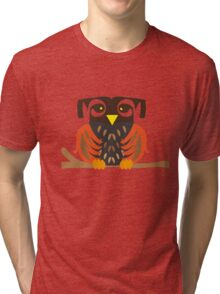 Owl sitting on a tree branche. Tri-blend T-Shirt