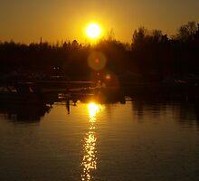 Sunset in harbor by Arve Bettum