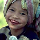 Lahu girl with betel smile by John Spies
