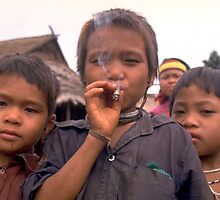 Karen hilltribe children smoking tobacco by John Spies