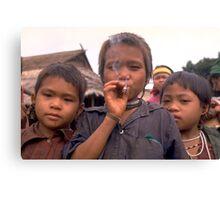 Karen hilltribe children smoking tobacco Canvas Print