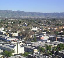 View of buildings and streets along with mountains in San Jose by ashishagarwal74