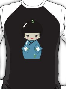 Cute Kokeshi doll on green T-Shirt