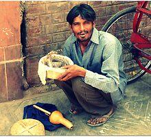 Snake man in Agra by zhengjiecn