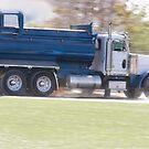 Trucks- Empty Dump Truck Speeding Away From a Construction Site by Buckwhite