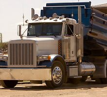 Trucks - Dump Truck Emptying Its Cargo on a Construction Site by Buckwhite