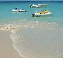 Jet skis at beach on Antigua, West Indies by John  Lambert