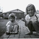 Kay walks her sister Karen; Ladue, MO, ca. 1958 by Bob Gaffney