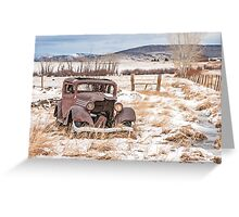 Rusty Antique Vehicle in a Field Covered with Snow Greeting Card