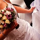 bride holding bouquet & dress by nayamina