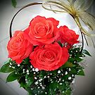 Basket with red roses by Ana Belaj