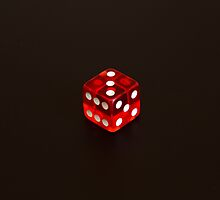 Dice isolated on black background by Marco7r7