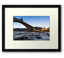 Old bridge over the river Framed Print