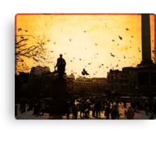 Pigeons take flight in Trafalgar Square Canvas Print