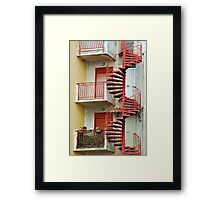 Winding staircase in red Framed Print