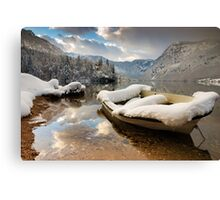 Snow covered boat on Lake Bohinj in Winter Canvas Print