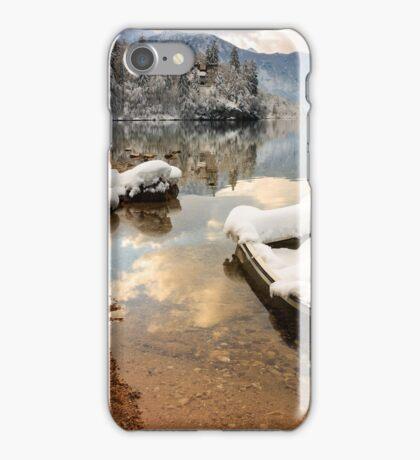 Snow covered boat on Lake Bohinj in Winter iPhone Case/Skin