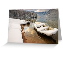 Snow covered boat on Lake Bohinj in Winter Greeting Card