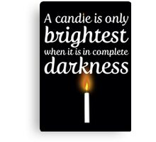 A candle is only brightest in complete darkness Canvas Print
