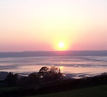 Sunset at Llanfairfechan. by Michael Haslam