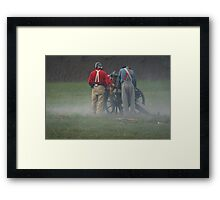 Loading the cannon Framed Print