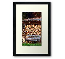 Bench at the firewood place Framed Print