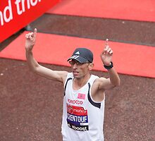 Chentouf from Morocco crosses the finish line of the Virgin money London Marathon by Keith Larby