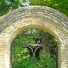 Gate arch with sunlight by Paul Morley